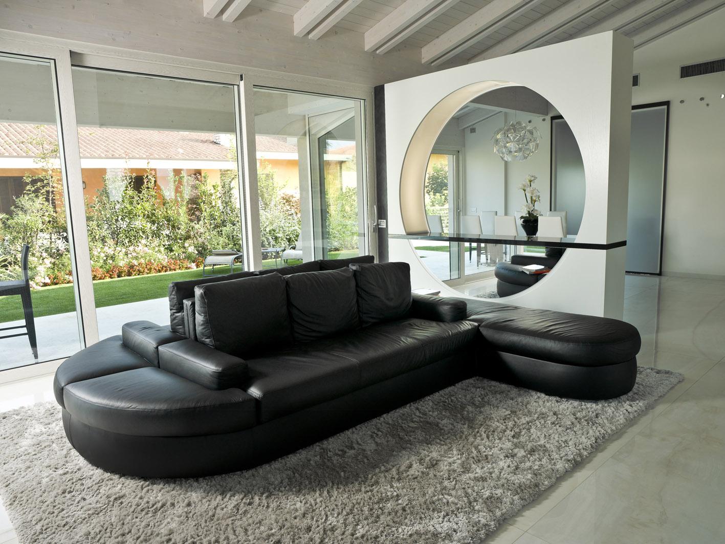 living moderno MG architettura d'interni simone casarotto design divano pelle nero tappeto pelo