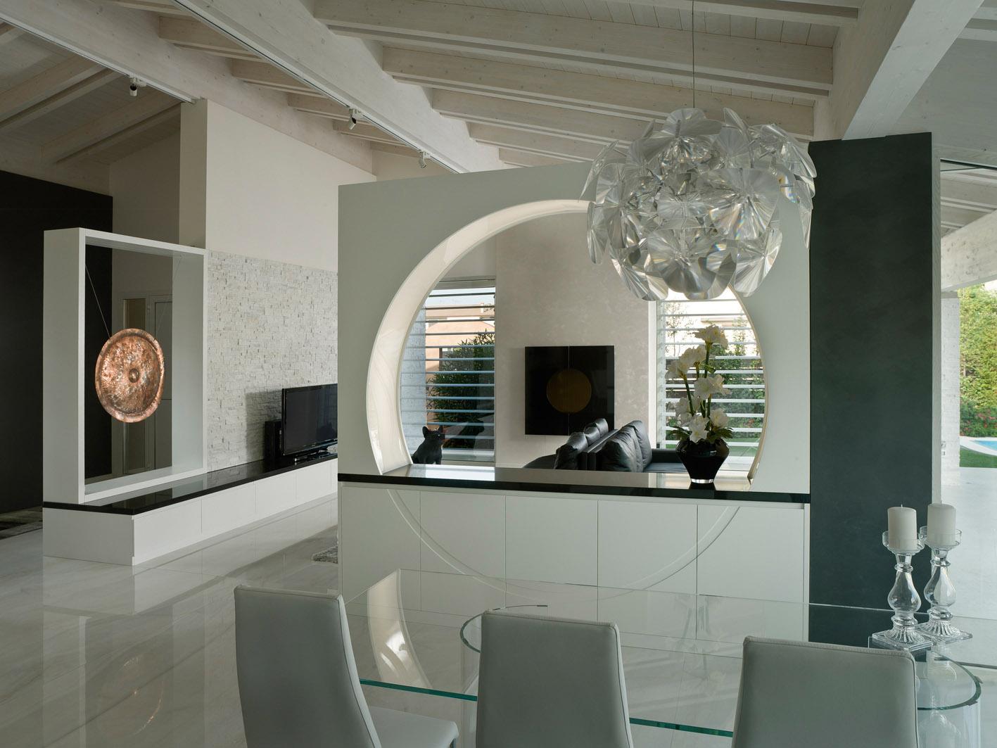 living moderno MG architettura d'interni simone casarotto design marmo nero marquinia gong tibetano